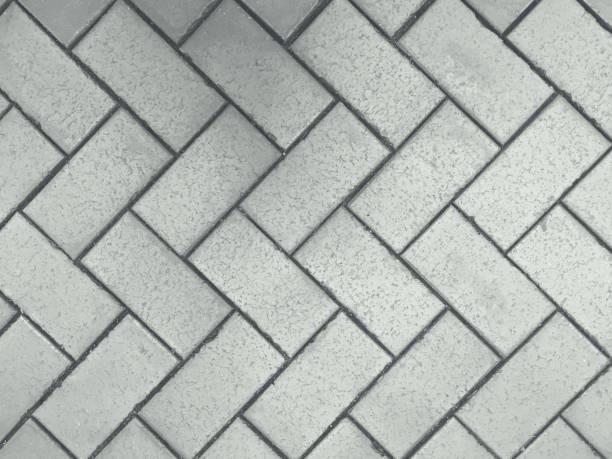 fischgrätmuster silber - zement terrasse stock-fotos und bilder