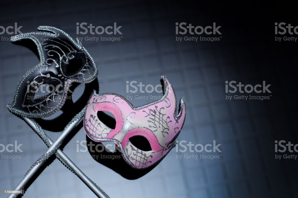 Hers and His Masks on Black Background stock photo