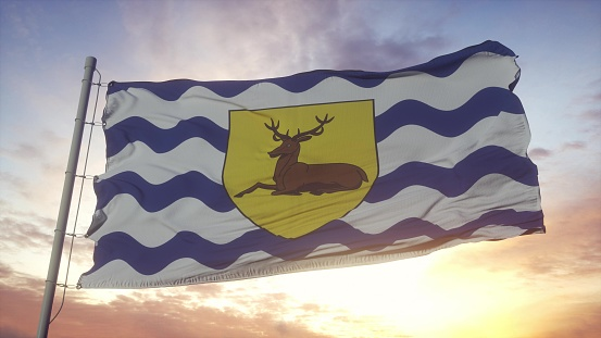 Hertfordshire flag, England, waving in the wind, sky and sun background. 3d rendering.