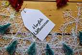 istock Herzlich Willkommen write on label with wooden backgroud. It means Welcome. Frame of Christmas Decoration. 1199234334