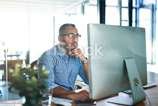 Cropped shot of a handsome young businessman working in his office