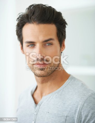 Head and shoulder shot of a handsome young man looking away