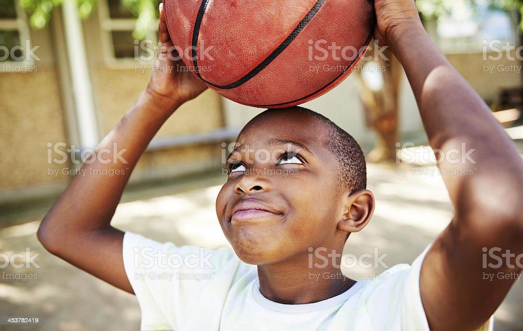 He's a huge basketball fan! stock photo