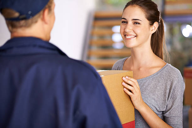 He's a professional who'll care for your parcel stock photo