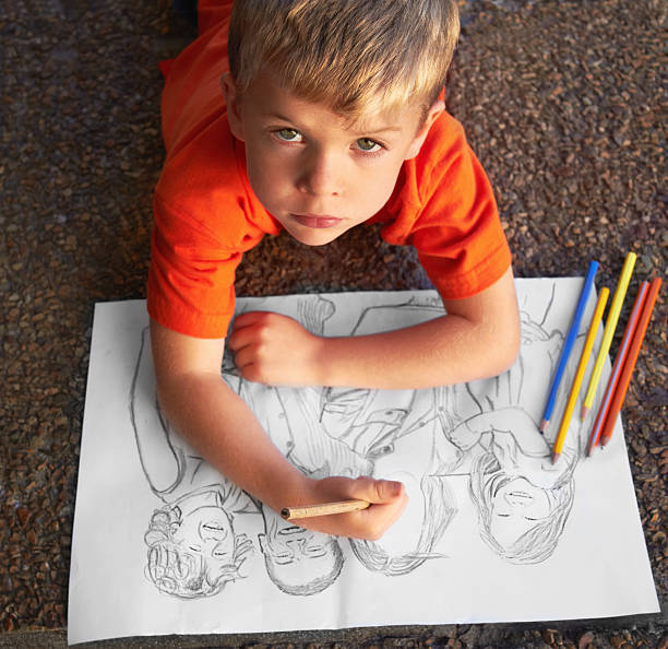 He's a talented sketch artist! Talented little boy drawing an incredibly advanced sketchhttp://195.154.178.81/DATA/istock_collage/0/shoots/781156.jpg child prodigy stock pictures, royalty-free photos & images