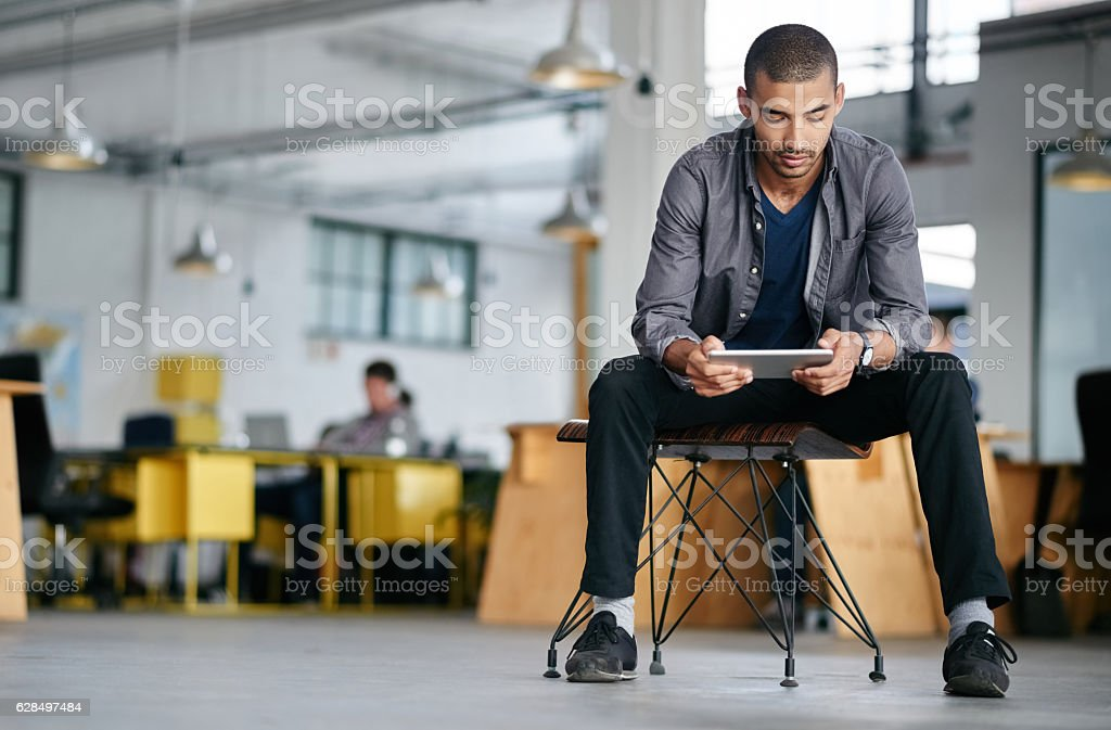 He's a tech savvy young designer stock photo