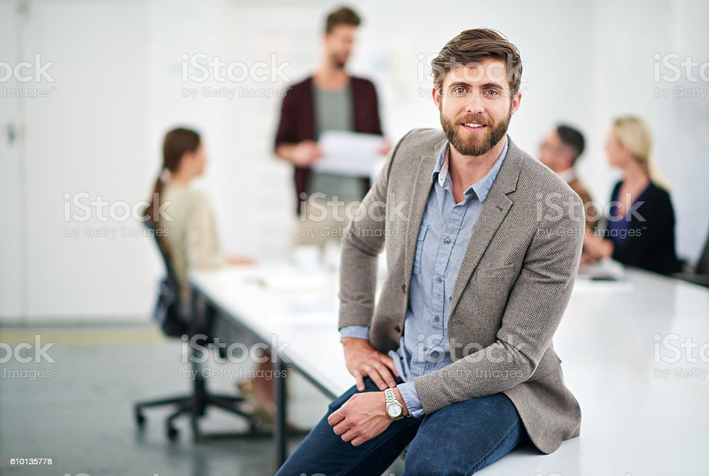 He's a young gun in the company stock photo