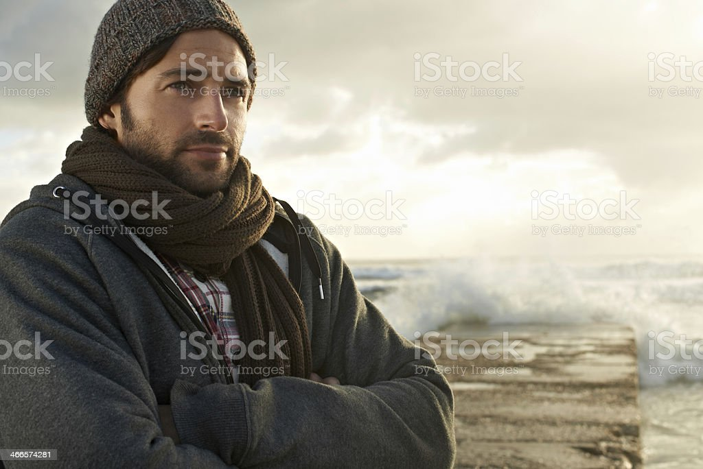 He's always close to the ocean stock photo