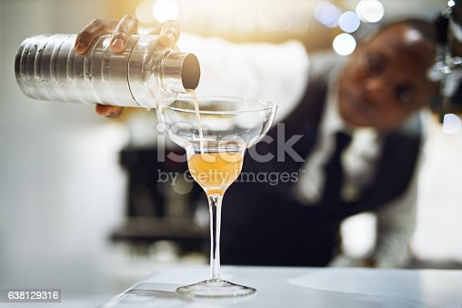 Cropped shot of a bartender making a cocktail