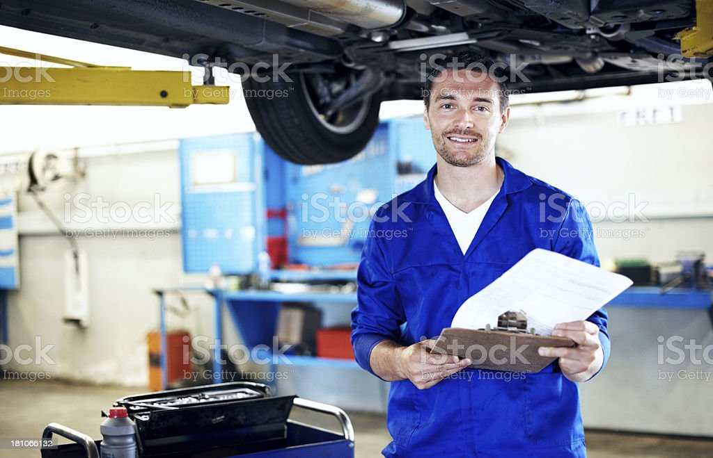 He's an experienced vehicle assessor stock photo