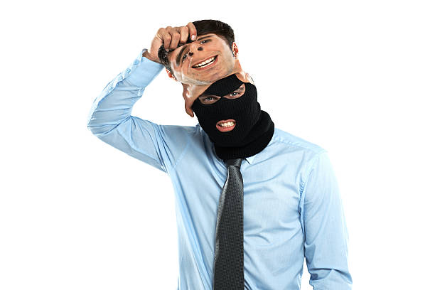 he's an identity thief - mask disguise stock photos and pictures