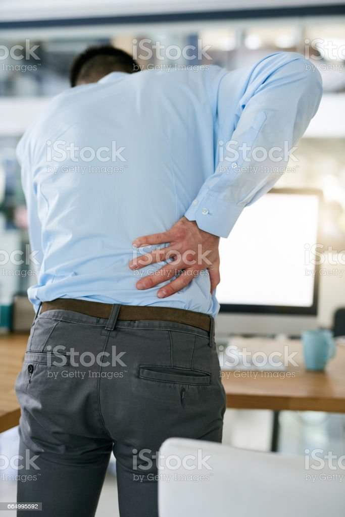 He's been sitting down for too long stock photo