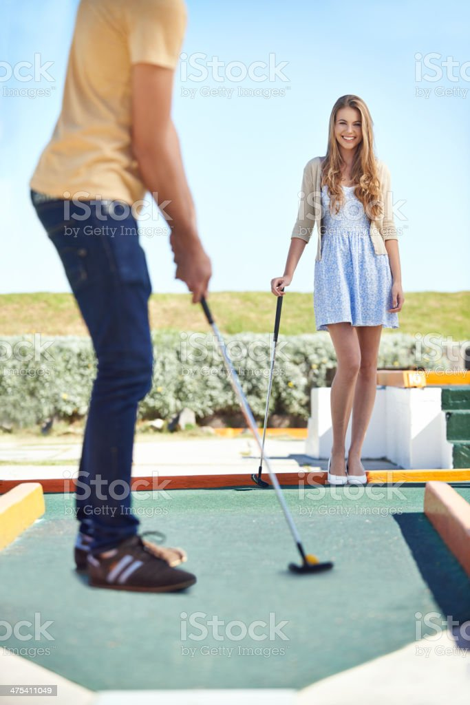 He's definitely the better putt-putt player stock photo