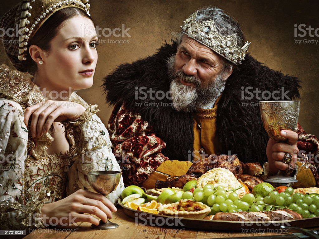 He's feasting and his goblet is full...again! stock photo