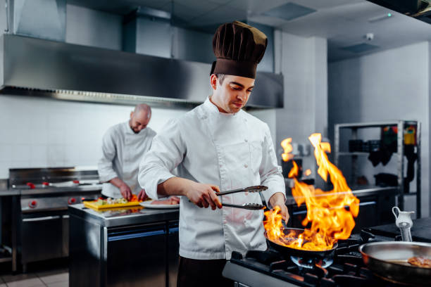 He;s got a special cooking skill stock photo