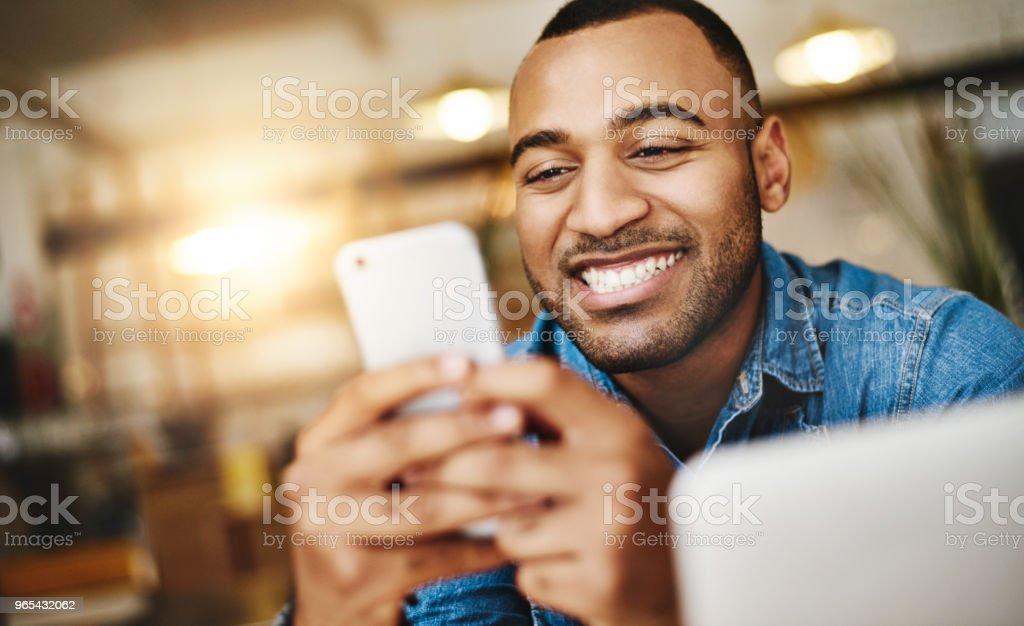 He's got apps to entertain for days zbiór zdjęć royalty-free