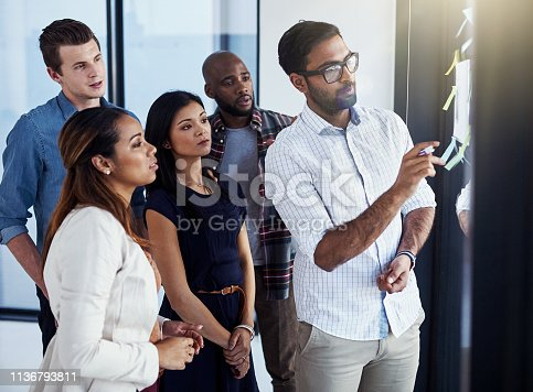 496441730istockphoto He's got everyone's attention with his new idea 1136793811