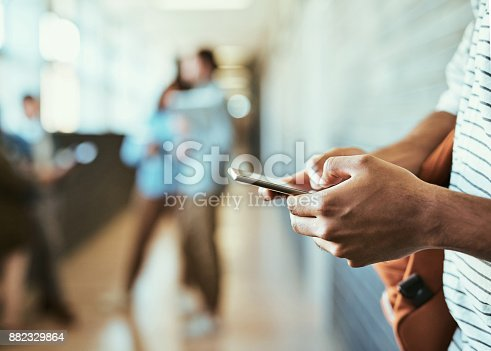 istock He's got his timetable on his cellphone 882329864