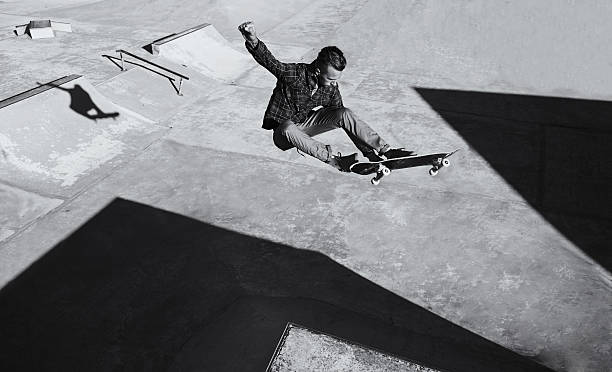 He's got skill A black and white shot of a skateboarder doing tricks at a skatepark skateboard stock pictures, royalty-free photos & images