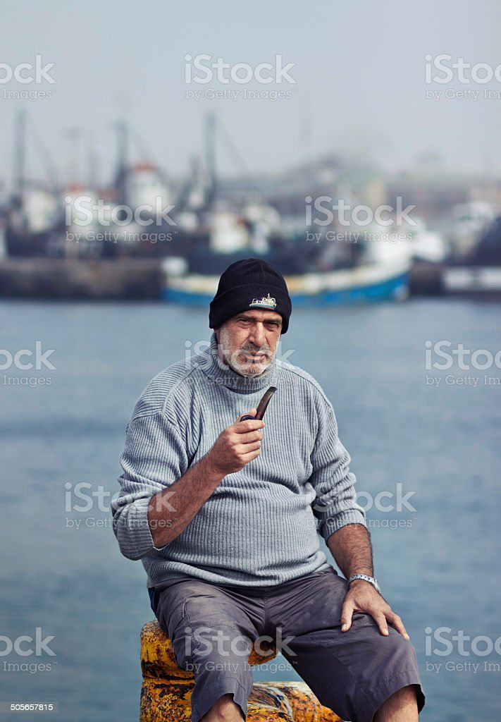 He's got some fishing stories to tell you! stock photo