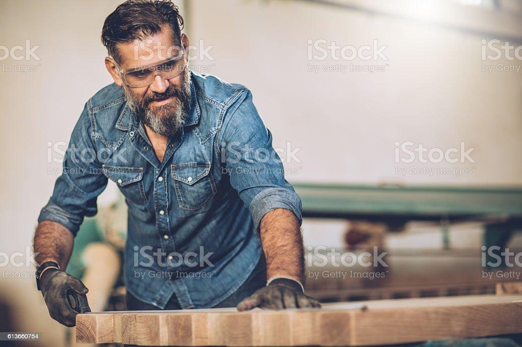 He's happiest in his workshop stock photo