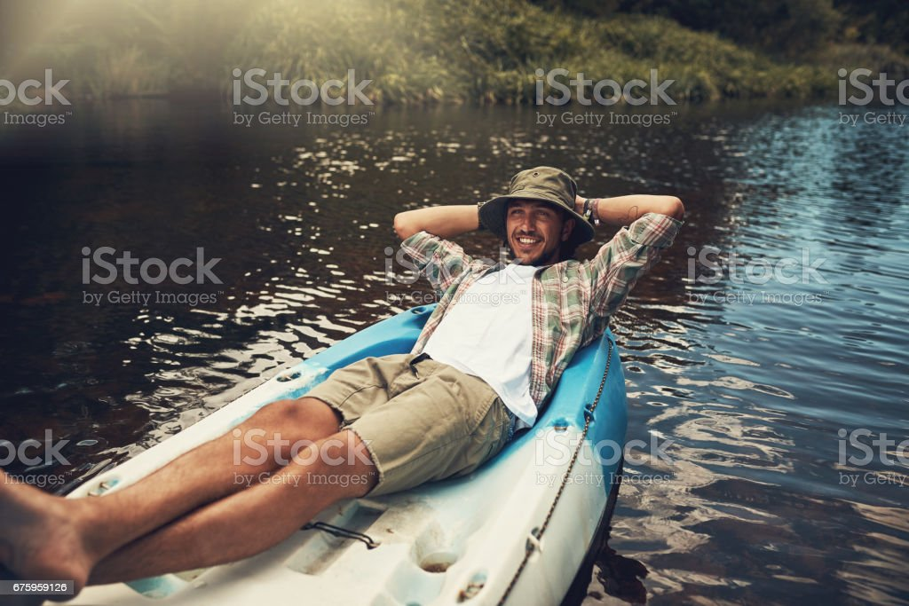 He's happiest when he's floating on the lake stock photo