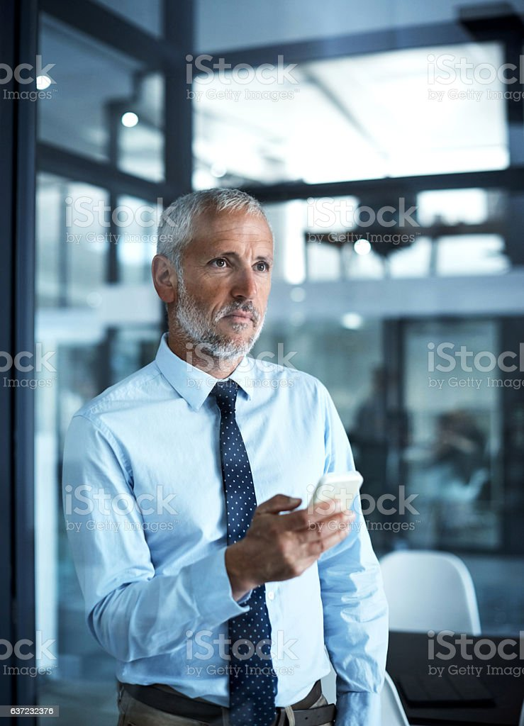 He's just a message away stock photo