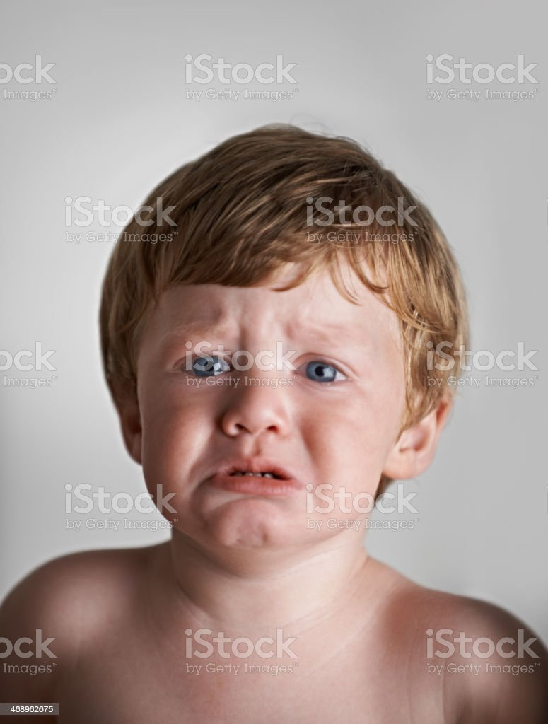 He's not a happy baby stock photo