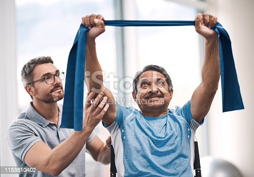 Shot of a senior man exercising with a resistance band during a rehabilitation session with his physiotherapist