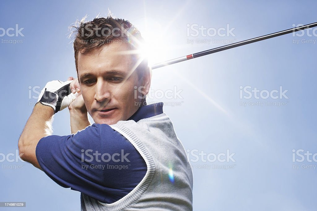 He's ready to unleash his swing royalty-free stock photo