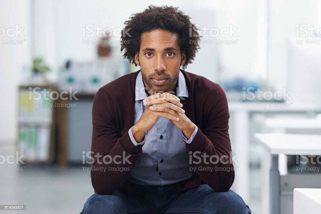 He's serious about succeeding at work stock photo