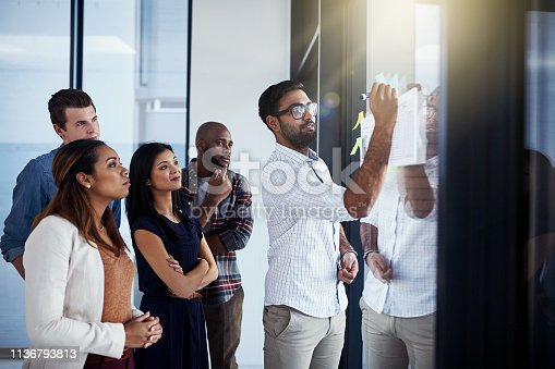 496441730istockphoto He's showing them a new way of doing things 1136793813