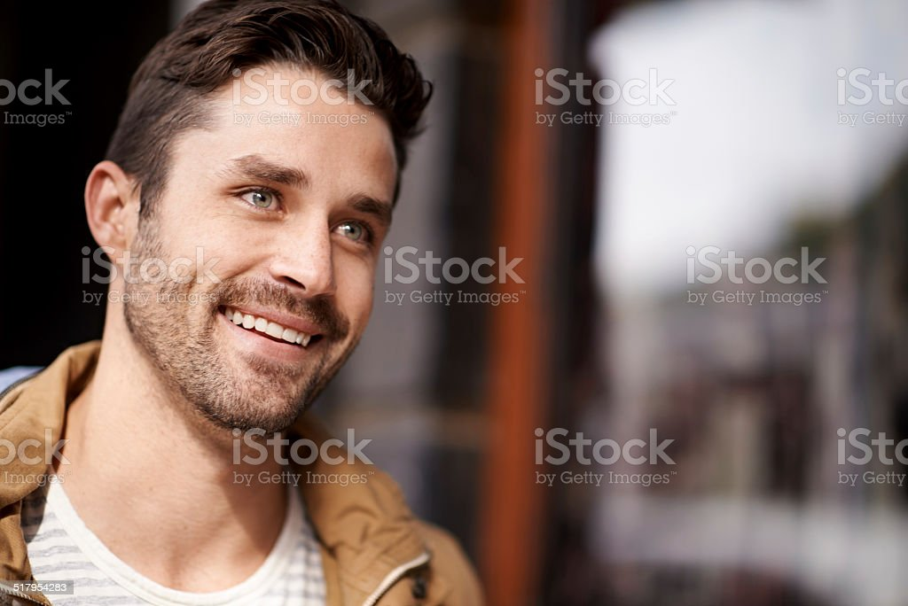 He's smiling at the sights stock photo
