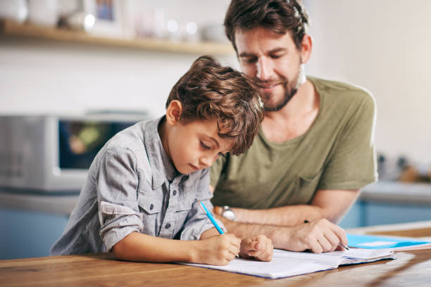 he's so smart - homework stock photos and pictures
