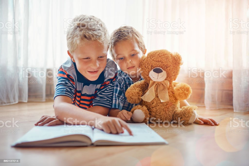 He's such a good big brother stock photo