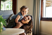 Cropped portrait of an affectionate young single mother spending time with her little son in their living room at home