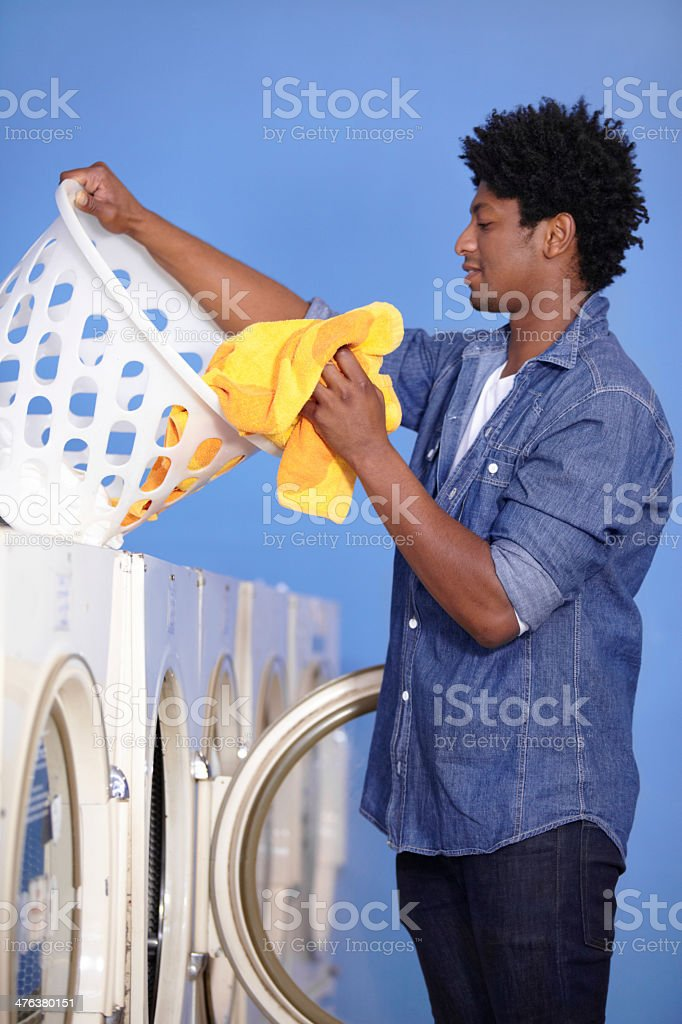 He's taking care of the laundry stock photo