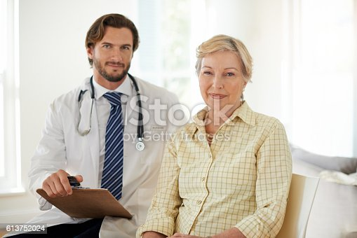 Portrait of a doctor and his senior patient in a clinic