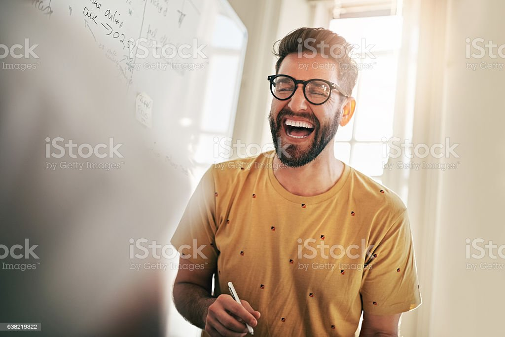 He's the one that brings humour to the team stock photo