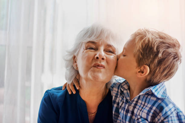 He's the sweetest little boy Cropped shot of a senior woman spending time with her loving grandson grandson stock pictures, royalty-free photos & images