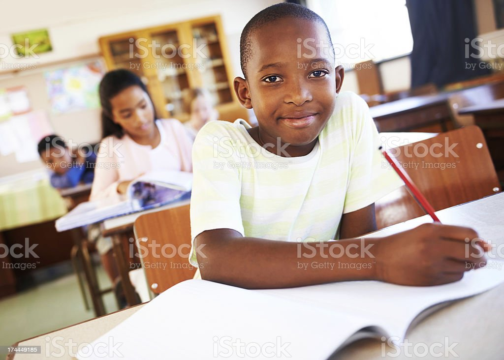 He's working hard to keep his grades up! stock photo