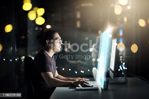 Cropped shot of a male computer programmer working late in the office on a new code