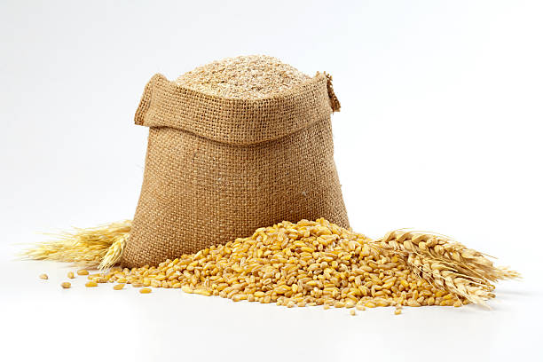 hessian sack of grain and wheat - sack stock pictures, royalty-free photos & images