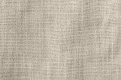 istock Hessian sackcloth woven fabric texture background in beige cream brown color 1031169660