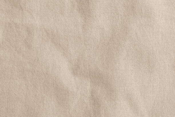 hessian sackcloth woven fabric texture background in beige cream brown color - textile stock photos and pictures