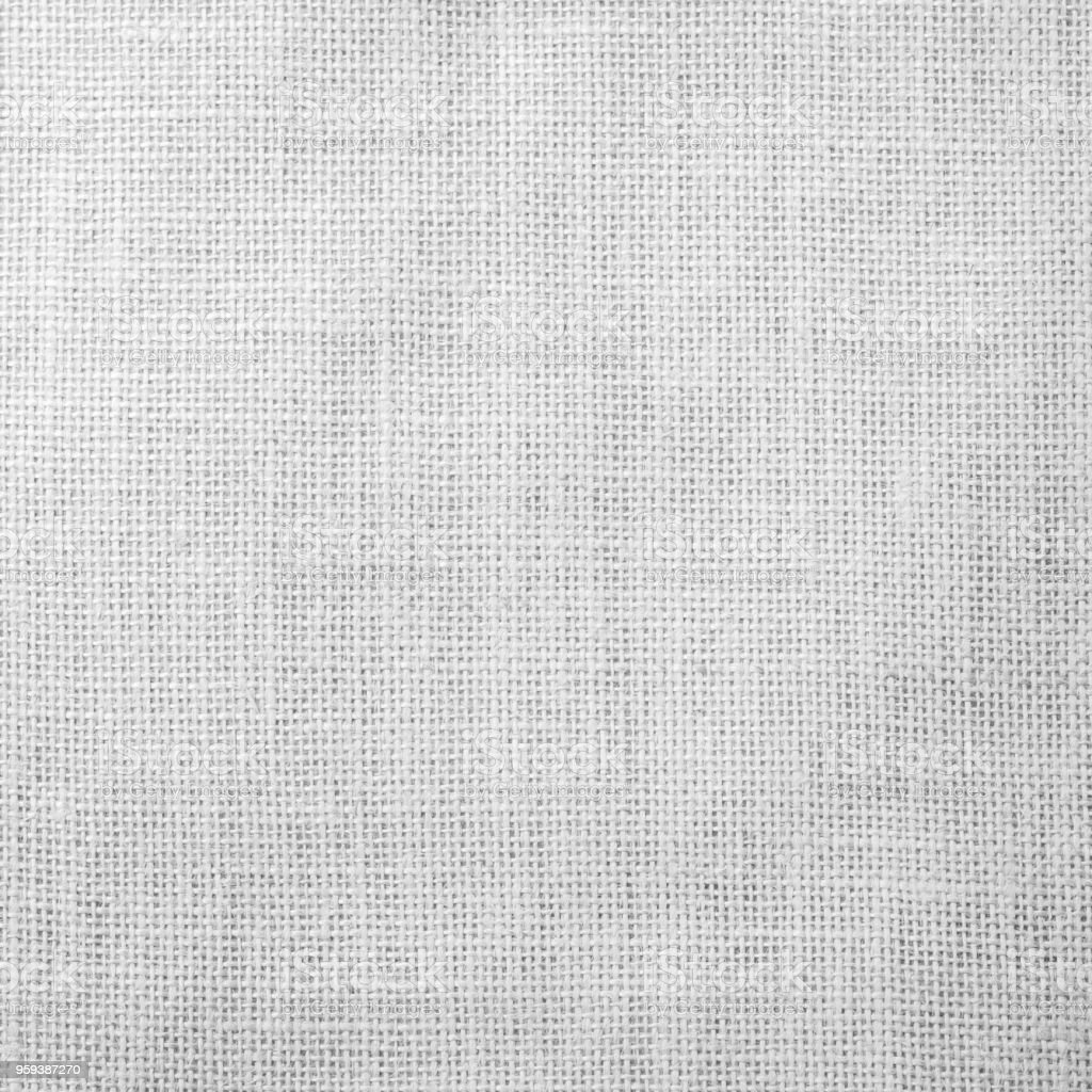 Hessian sackcloth woven fabric texture background light white grey color stock photo