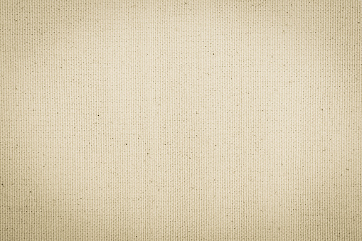Hessian sackcloth woven texture pattern background in light cream beige brown color