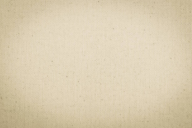 Hessian sackcloth woven texture pattern background in light cream beige brown color stock photo