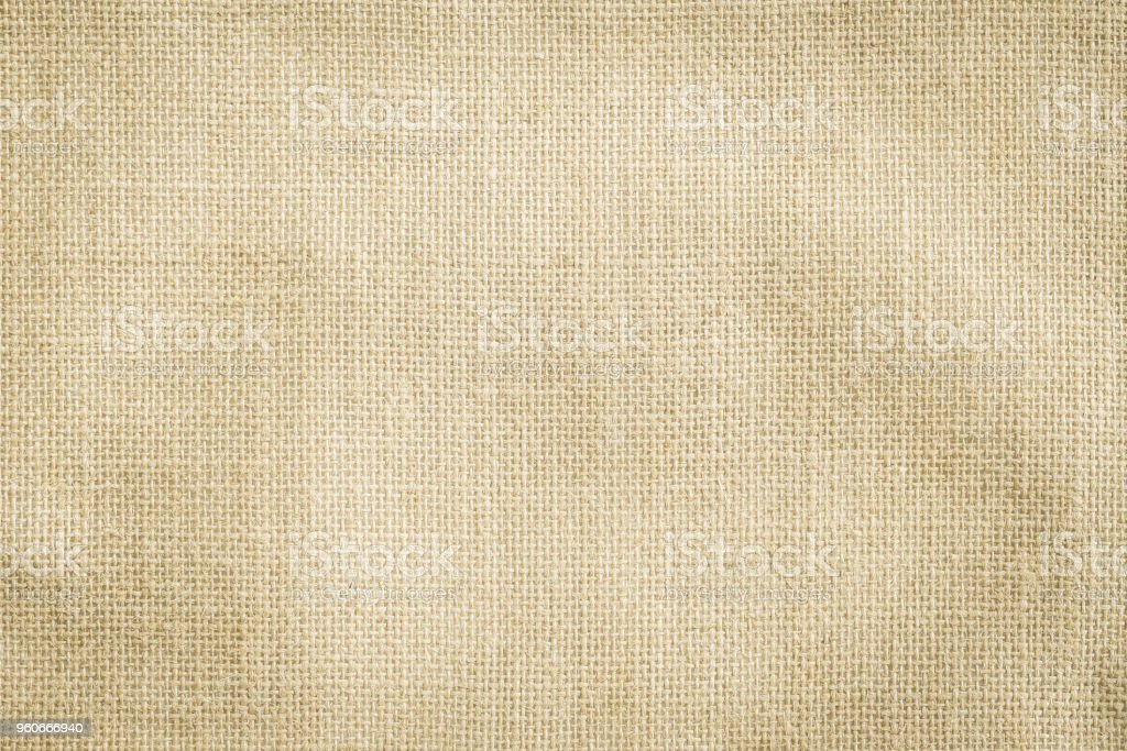 Hessian sackcloth woven texture pattern background in yellow beige cream brown color stock photo