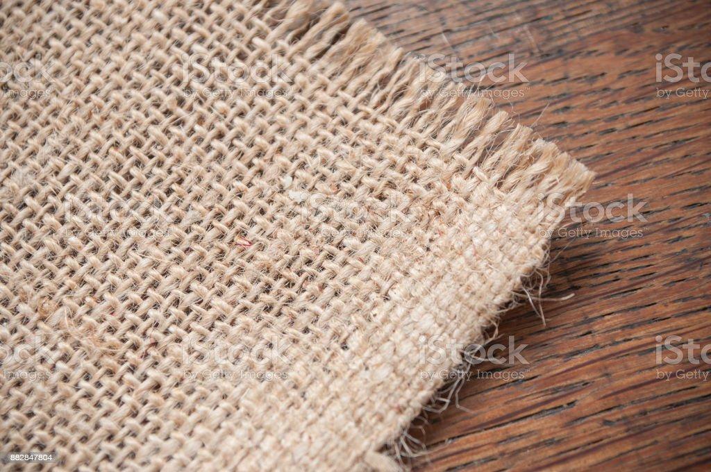 hessian texture on wooden background stock photo